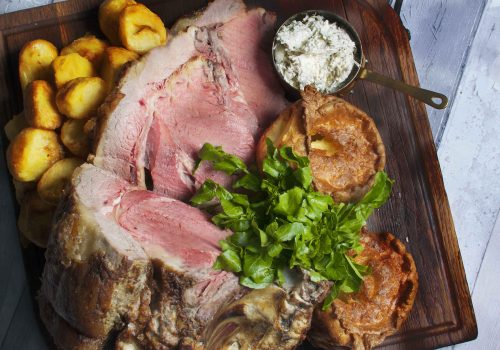Lamb Roast with baked potatoes and Yorkshire puddings